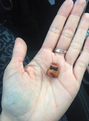 figurine piece in woman's hand